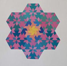 Mandala: composizione di moduli a base triangolare.