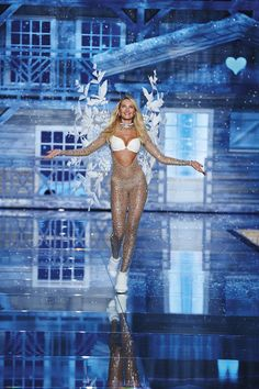 Flurries can't stop Candice Swanepoel on the Victoria's Secret Fashion Show runway...not in a crystal-studded bodysuit with snow-kissed wings. | Very Sexy Push-Up Bra & Matching V-string Panty