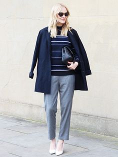 Marie Hindkær Wolthers of Blame It On Fashion in the perfect workwear look: striped sweater + trousers and a jacket over the shoulders