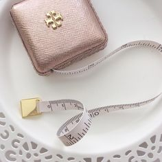 Something I never knew I needed until I had it! A @toryburch rose gold tape measure!
