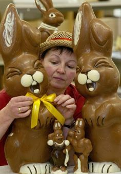 HORNOW, Germany: An employee of the confectionery Felicitas decorates a chocolate Easter bunny with a bow at the company's production site in Hornow near Cottbus, eastern Germany, 04 March 2005. Three weeks before Easter, the family enterprise runs in full swing its production of Easter sweets made of Belgian chocolate. AFP PHOTO DDP/MICHAEL URBAN GERMANY OUT (Photo credit should read MICHAEL URBAN/AFP/Getty Images)