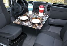 Front dining table - brilliant idea for front swivel seat usage. I love this! Got it from the SMB forum.