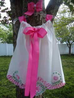 Pillowcase dress - like the bow in the front.  :)