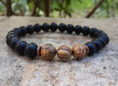 Hey, I found this really awesome Etsy listing at https://www.etsy.com/listing/200786830/mens-onyx-pictured-jasper-mala-bracelet