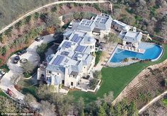 Tom Brady and Gisele Bundchen's 20million dream home    Read more: http://www.dailymail.co.uk/tvshowbiz/article-2089378/Tom-Brady-Gisele-Bundchens-20million-dream-home-finally-finished, with lighting, rainwater recovery systems, waste reduction and recycling programs, energy-efficient appliances and sustainable building materials.