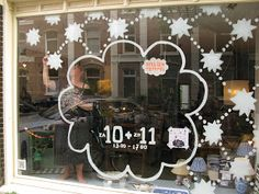 Atelier Tempel window painting.  Just changing up snowflakes by making them a little geometric.