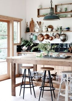 Rustic Kitchen with High ceiling, French doors, partial backsplash, Wood counters, Breakfast bar, Stone Tile, Undermount sink