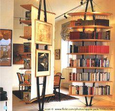 Bookshelves, UK magazine scan © Emy aka www.flickr.com/people/apple-jack Interior Design. Circular bookshelves. Freestanding curved wall bookshelves. Designer/Magazine not attributed ... HOW TO FIND the ORIGINAL WEB SITE of an image: http://pinterest.com/pin/86975836525507659/ PINTEREST on COPYRIGHT: http://pinterest.com/pin/86975836526856889/ The Golden Rule: http://pinterest.com/pin/86975836525355452/