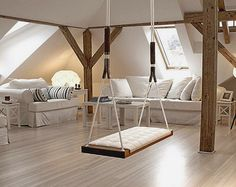 Fun interior design and decorating ideas with this swing seat / bench inside this room