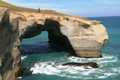 Tunnel Beach Arch is located on the Otago Peninsula near to the city of Dunedin on New Zealand's South Island.  To reach the arch you have to cross private land which is closed between 1st August and 30th October due to lambing. The span is about 50 feet and the height about 30 feet. Photo by Ray Millar.