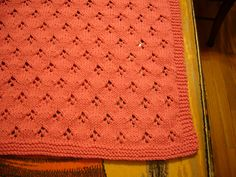 Ravelry: Lace Car Seat Blankie pattern by Jean Adel.  I like this eyelet pattern.