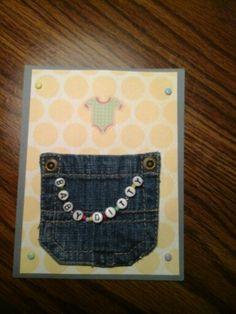 Denim pocket holds gift card for a baby shower.