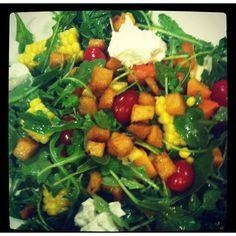 Arugula salad w grape tomatoes, roasted squash, fresh corn, goat cheese and polenta croutons. W red wine vinegrette.