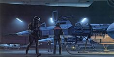 ANH: Y-Wing Fighters are being unplugged from their ground system in the Rebel hangar at Massassi. For the figure at the left, McQuarrie used a World War II photo of a Navy pilot running across the flight deck with clipboard in hand, changing the uniform but capturing the gesture. The pilots have helmets which are capable of life-support, working automatically whenever a malfunction in their aircraft occurred. Fighters are designs by Colin Cantwell, revised by Joe Johnston.