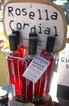 Rosella Cordial - Wild Hibiscus - Honeycomb Valley Farm. Beautifully refreshing & delish this cordial is unique in flavour. Dilute 1 part to 6-8 parts water or mineral water & enjoy! Organically grown, carefully hand-picked & cordialled right here at the farm.  #HoneycombValleyFarm #FarmhouseAU #drinks #rosella #hibiscus #cordial #beverage  #handpicked