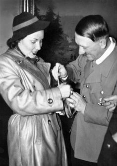 Hitler and Lida Baarova in 1937. She was Goebbels lover for almost two years and all that caused Hitler much consternation since she was Czech (thus an Untermensch in his eyes). Hitler told Leni Riefenstahl in 1937 that he could never have sex with a woman who was not German. (via putschgirl)