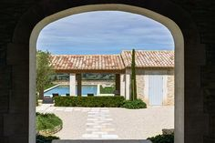 The covered pool house has traditional, terracotta roof tiling. Provencal House