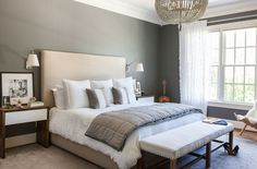 A serene master suite spotlights a beaded chandelier and a pair of bedside tables created by the designer's husband, artist and furniture designerJames Wilson.