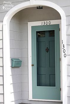 The color of the exterior screen door matches the front door color. The color of the exterior screen door matches the front door color. The color of the exterior screen door matches the front door color. Front Door With Screen, Diy Screen Door, Front Storm Door Ideas, Screen Door Grill, Black Screen Door, Metal Screen, Door Paint Colors, Front Door Colors, Teal Front Doors
