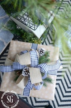 Christmas gift wrapping ideas, using gingham ribbon and some outdoorsy elements. Wrapping Ideas, Elegant Gift Wrapping, Creative Gift Wrapping, Wrapping Gifts, All Things Christmas, Christmas Time, Christmas Crafts, Christmas Decorations, Simple Christmas