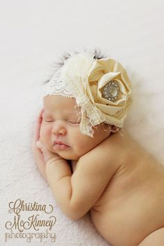 Vintage inspired Ivory satin lace headband,chiffon netting,cream feather headband-newborn, baby,girl headband-photo prop-flower girl- bridal. $14.95, via Etsy.