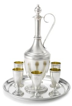 A Fabergé Silver Liqueur Set, Moscow, circa 1895 comprising a ewer-form decanter with stopper, a tray, and six goblets, struck K. Fabergé in Cyrillic with Imperial Warrant or KF in Cyrillic, 84 standard