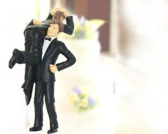 How about a fun, non-traditional wedding topper?  Two smartly dressed men in suits, being frisky and getting hitched.