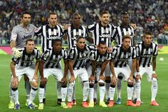 Team of Juventus FC line up prior to the Serie A match between Juventus FC and Udinese Calcio at Juventus Arena on September 13, 2014 in Turin, Italy.