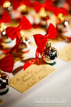 No Christmas-themed wedding is complete without darling ornament escort cards tied with a bow.