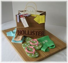 Hollister Shopping Bag - Sculpted shopping bag covered with fondant; gumpaste handles; royal icing letters; fondant flip flops and clothing