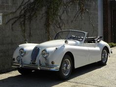 The Jaguar XK140, introduced in late 1954 and sold as a 1955 model. Exterior changes that distinguished it from the XK120 included more substantial front and rear bumpers with overriders, and flashing turn signals (operated by a switch on the dash) above the front bumper. #jaguar #cars #hartwell
