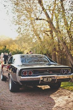 Dodge Charger. There is nothing better than vintage cars. This photo opens up a whole world in my mind. Stunning.