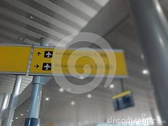 Gates indication ol yellow sign in arrival departure area in airport