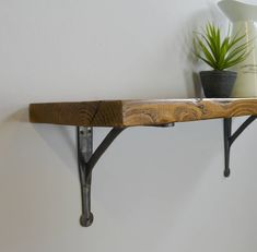 Reclaimed Wood Shelf With Iron Brackets Reclaimed Wood Shelves, Wooden Wall Shelves, Wood Shelf, Wooden Walls, Cast Iron Brackets, Utility Shelves, Wood Colors, Outdoor Furniture, Outdoor Decor