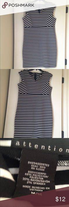 Casual dress Causal dress black and white knit material not thin.  Comes above knee.  Excellent condition Attention Dresses