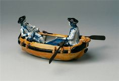 A Dutch Delft polychrome group, depicting two men in a rowing boat  Delft, ca. 1760 - 1770  Height 11 cm, width 21 cm  Provenance: private collection, France. OTT Fine Arts