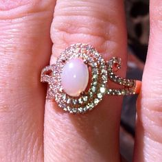 1/29/16 SALE  OPAL 925SS ROSE GOLD  RING!!! SALE TODAY 1/29/16... This is NEW IN BOX. it does not come with any TAGS, came in jewel box in pic.. THIS IS STUNNING!!!... 1.88CT OVAL WHITE OPAL CABOCHON SET IN 925 STERLING SILVER PLATED IN ROSE GOLD. Has double Halo mounting with beautiful scroll side accents. This is NEW IN BOX.. Size 9.  REASONABLE OFFERS CONSIDERED. Thanks for stopping by my closet! Jewelry Rings
