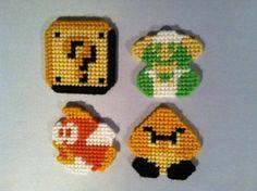 Mario 8-bit plastic canvas. Coin box, dying Luigi, cheep cheep, and goomba. coin box, cheep, plastic canvas, boxes, canva craft, bricks, super mario, 8bit, canvases