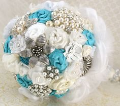 Turquoise wedding bouquet, maybe with silver and gems and no pearls. Beautiful :)