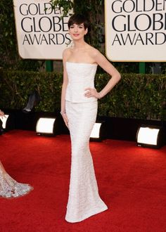 Golden Globes 2013: Best and Worst Dressed: Honorable mention: Anne Hathaway looks pretty perfect in Chanel. It may not be the most exciting look, but that peplum got everyone buzzing about pregnancy rumors, so that's fun.