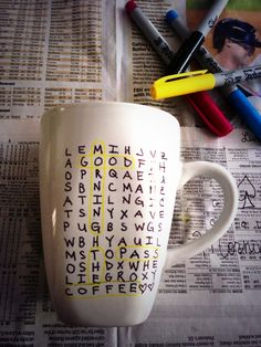 Buy a mug from the dollar store and decorate with sharpies! Stick in the oven for 30 min @ 350 degrees. Inspired by crossword puzzle from the newspaper !