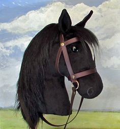 Black hobby-horsing horse in the larger size, with removable leather bridle.