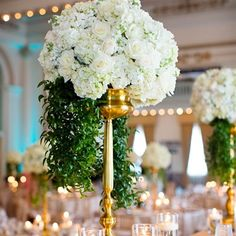 Jump on the 2014 wedding flower trend! Huge centerpieces that are lush and large are a huge 2014 trend.