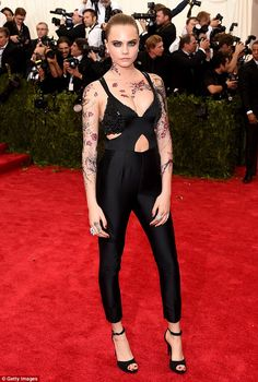 Making an impact: It's unlike Cara, picture on the red carpet at the Metropolitan Museum o...