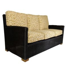 The Venezia Sofa, Teak & Resin Weave from Walters Wicker Exterior Collection.