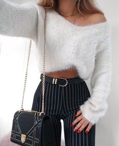 Soft white off the shoulder sweater with black and white striped pants.