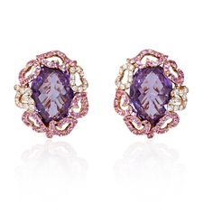Diamond, Sapphire and Amethyst 18k Rose Gold Cluster Earrings (#5869)  Retail 4,070 USD   These gorgeous 18k rose gold cluster earrings, designed in Italy, feature 96 round cut pink sapphires, of exquisite color, weighing 1.50 carats total with 2 oval cut pink amethyst stones, of exquisite color, weighing 11.95 carats total and 38 round brilliant cut white diamonds of F color, VS2 clarity and excellent cut and brilliance, weighing .42 carat total. A great gift idea!