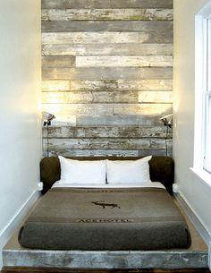 Floor to ceiling distressed wood head board.