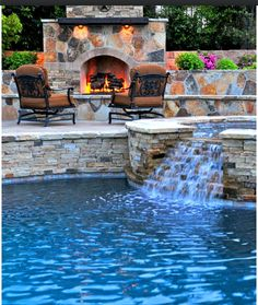 Pool with a cute fire place... Just beautiful