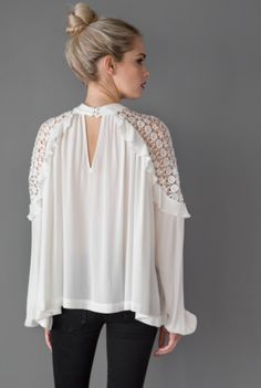 """In a flowly silhouette, this top features sheer crochet detailing on the shoulders and beautiful ruffles. This super sweet top is perfect for a nice dinner. Pair with the """"Audrey"""" silver studs to add some sparkle!"""